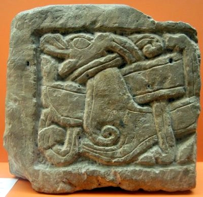 Viking tombstone from York, which shows an animal that fights against a snake