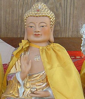 Budda with swastika in chinese temple