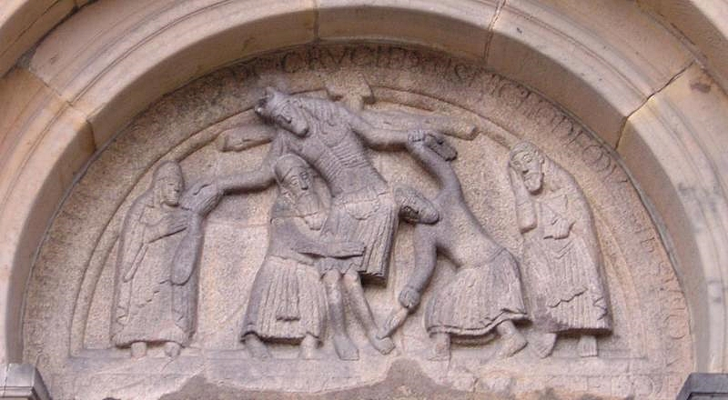 Jesus is taken down from the cross, motif over the cathedral door in Ribe Cathedral