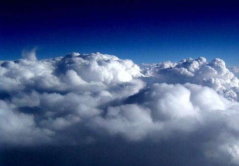 Topside of clouds viewed from airplane window