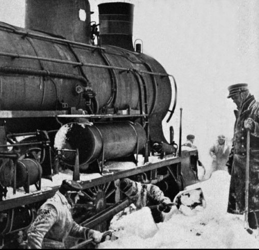 A locomotive is  dug free of snow on the Roskilde railway - Denmark - in winter 1942