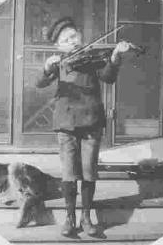 A boy  plays the violin