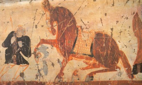 A blond steppe warrior displays his trained horse - cave painting from Dunhuang
