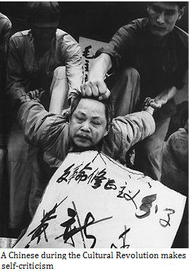 A Chinese during the cultural revolution makes self-criticism