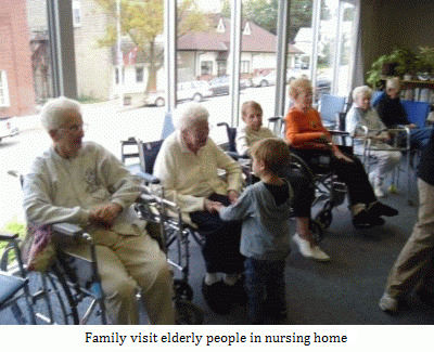 Family visit elderly people in a nursing home